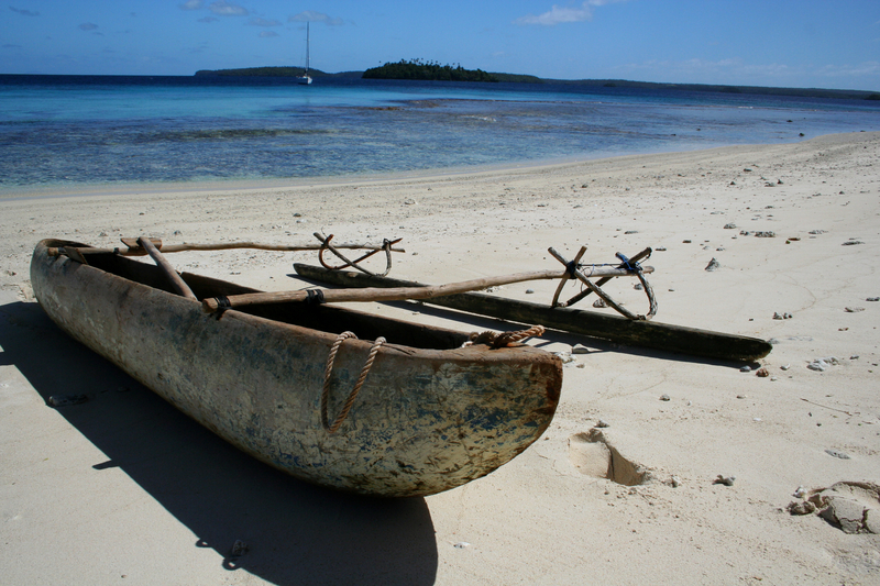 Native polynesian canoe on a remote beach on a small island in Vava'u, Tonga