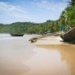 Old wooden boats on the beach in Palolem, Goa, India