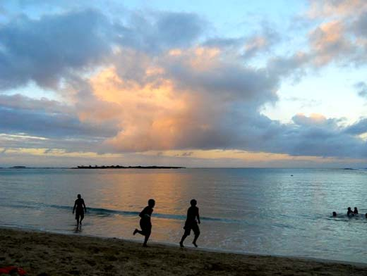 Kids playing at Hukilau Beach on the North Shore Copyright Ruth Elayne Kongaika