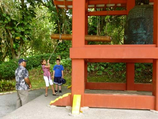 Ringing the Bell at the Byodo-In Temple   Copyright Ruth Elayne Kongaika